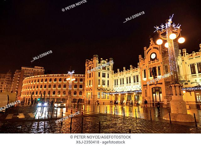 Exterior of the main railway station Estacio del Nord in Valencia lit up on a rainy night