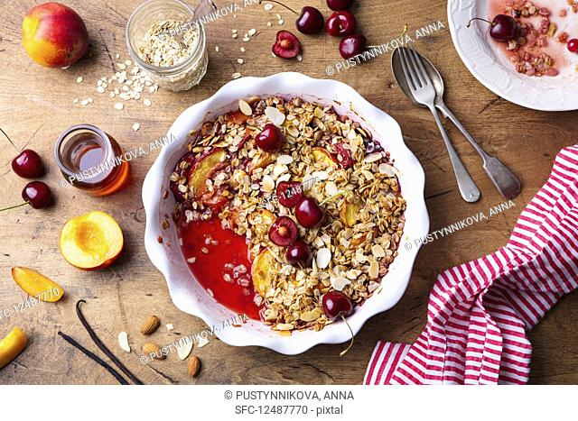 Peach and berry crumble in a baking dish