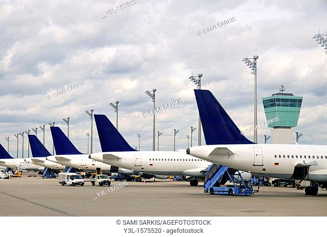 Stationary airplanes on tarmac by Air Traffic Control Tower, Munich, Germany