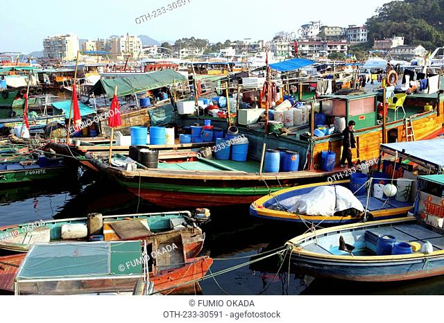Fishing boats anchoring at the pier of Sai Kung, Hong Kong