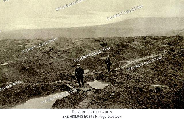 World War 1: Battle of Verdun. Two French soldiers in the pulverized landscape of Fort Douaumont. The Fort was shelled before the German capture on Feb