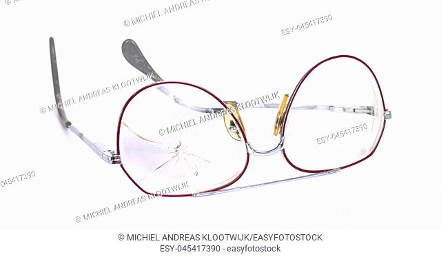 Vintage glasses, broken, isolated on a wwhite background