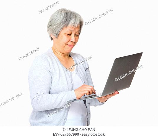 Retired woman use of laptop computer