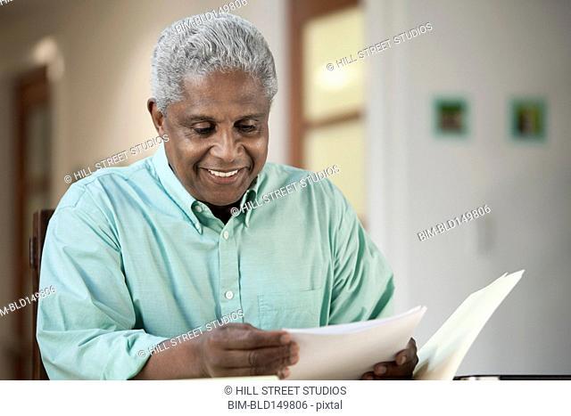 Black man looking at paperwork