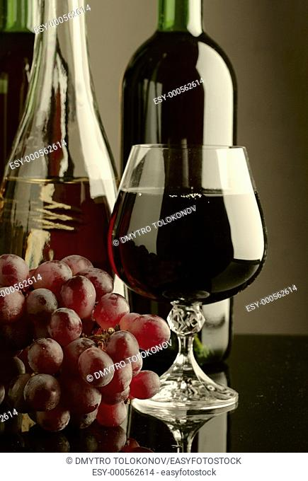 Old wine  Still life with wine bottles and goblet