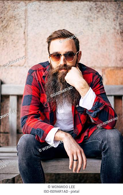 Portrait of man with beard wearing sunglasses