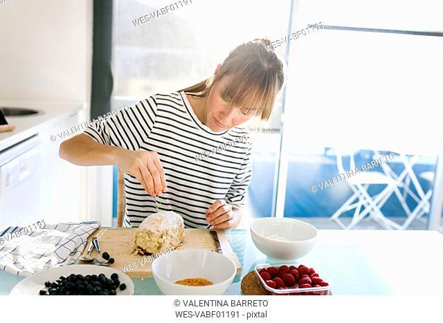 Young woman preparing vegan cake