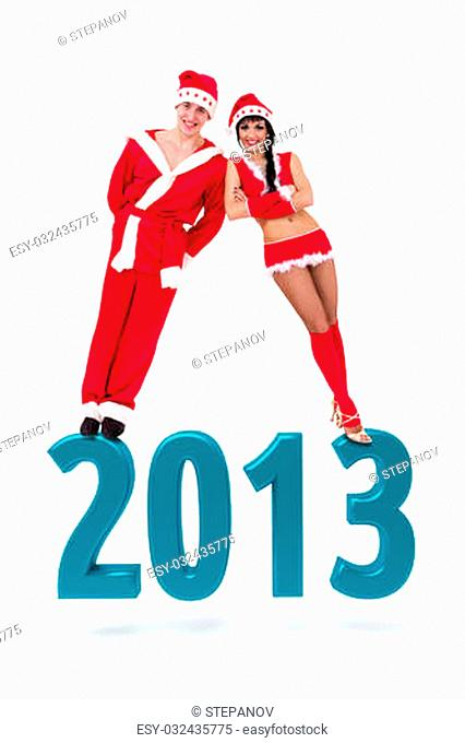 Happy young couple wearing santa claus clothes on a 2013 New Year sign, isolated on white