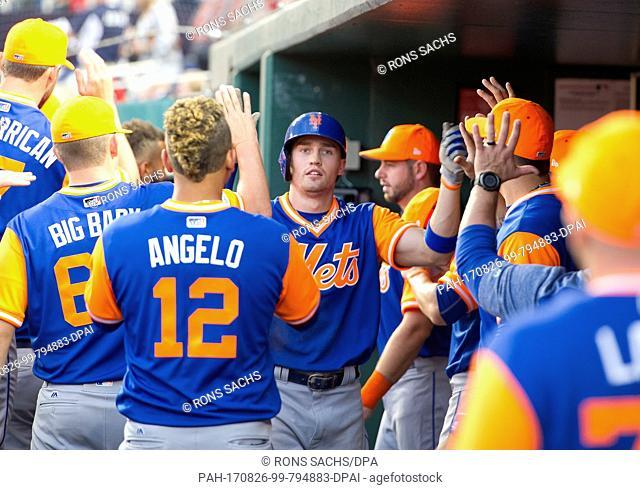 8982ab4d5 New York Mets center fielder Brandon Nimmo (9) celebrates his scoring in  the first