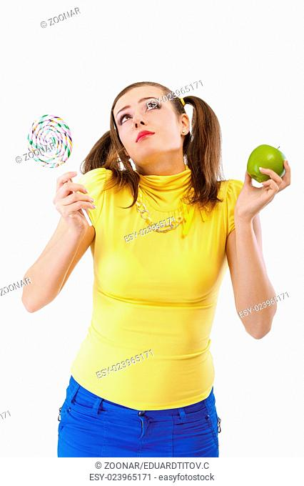 Girl-teenager with apple and candy