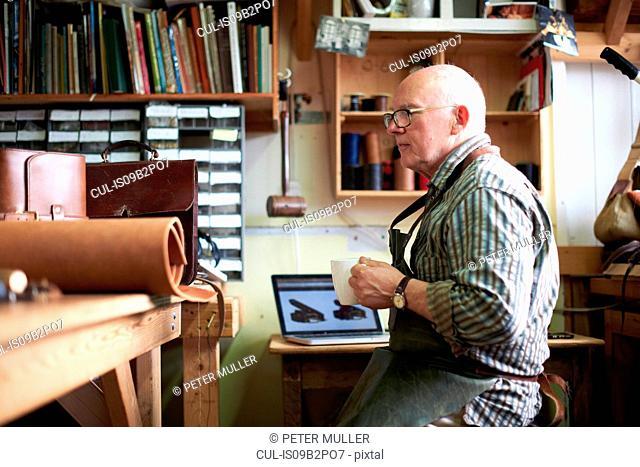 Male worker in leather workshop