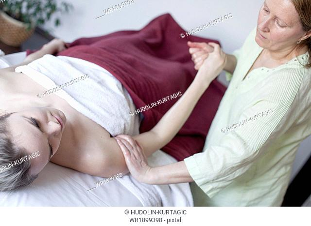 Young woman receiving Shiatsu treatment