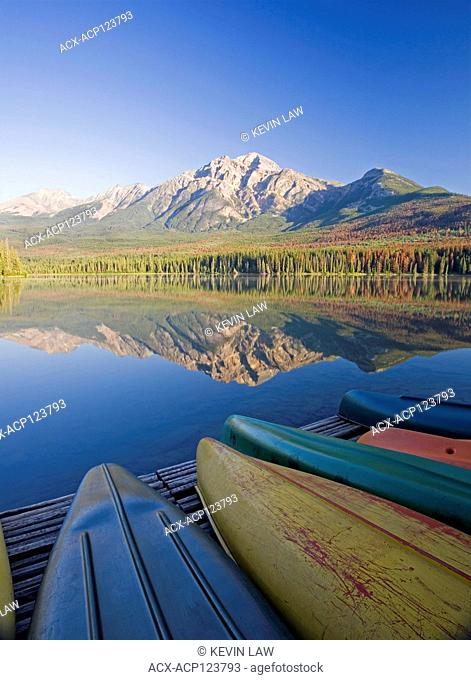 Canoes on dock at Pyramid Lake and Pyramid Mountain, Jasper National Park, Alberta, Canada