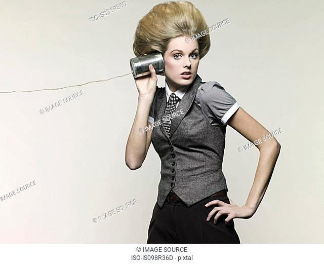 Businesswoman on tin can phone