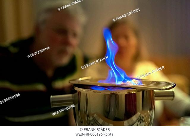 Couple watching blue flame of Feuerzangenbowle