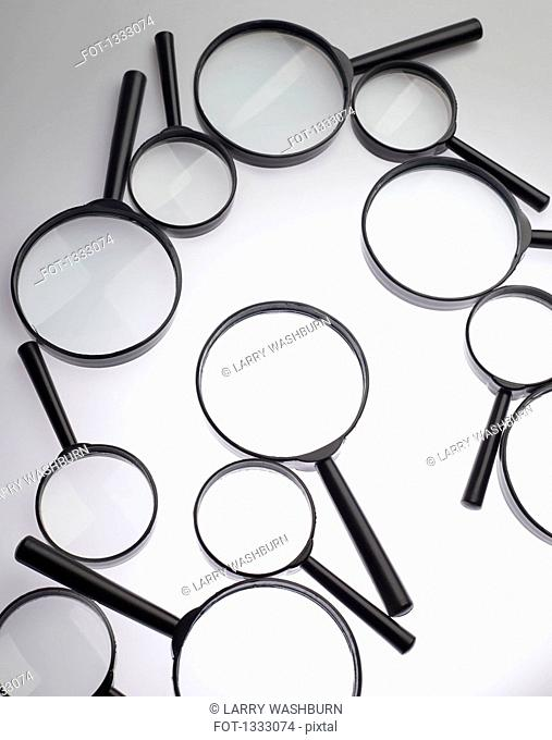 Magnifying glasses over white background