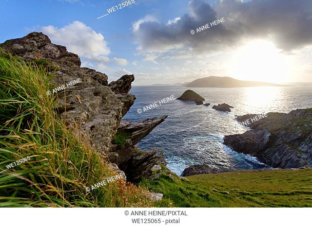 looking from dingle peninsula in western ireland (Europe`s most westerly point) towards blasket islands while sky is clearing, coordinates: 52