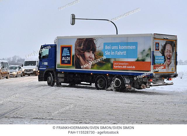 ALDI South Truck. Snow chaos on the streets of Bavaria - as here on the A94 motorway in Muenchen Riem is the busy traffic