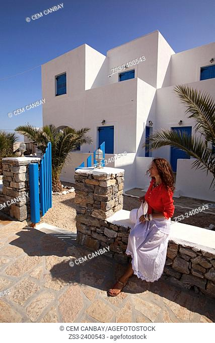 Woman in front of a typical Cyclades house, Koufonissi, Cyclades Islands, Greek Islands, Greece, Europe