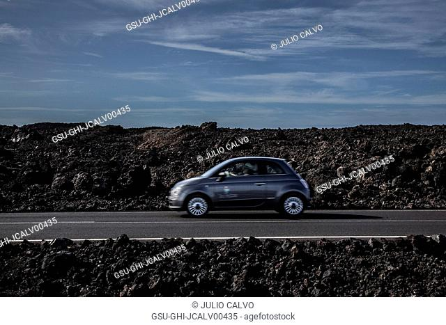 Car on Road Against Rocky Landscape
