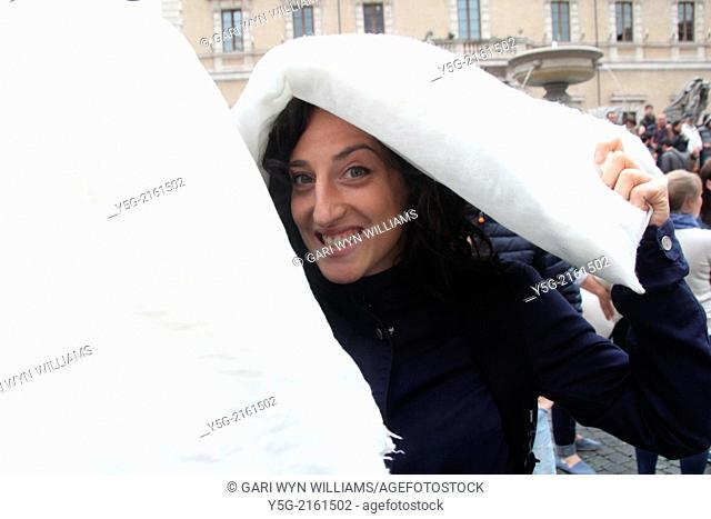 Rome Italy. 13th April 2014. International Pillow Fight Day in Piazza Santa Maria in Trastevere Square in Rome Italy