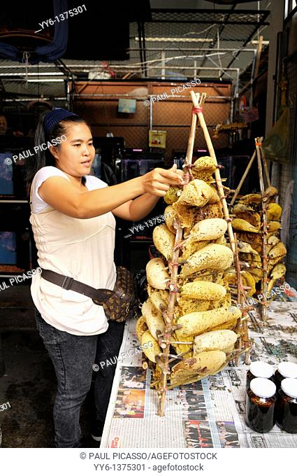 fresh honey on the comb for sale , chatuchak weekend market a kaleidoscope of exotic strange colours , smells and tastes