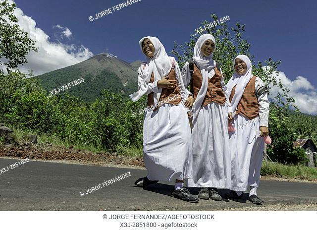 Muslim girls with uniform going home after school