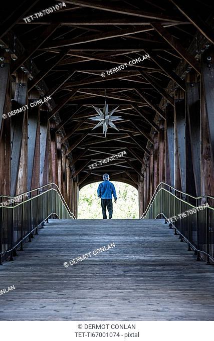 Man on covered bridge