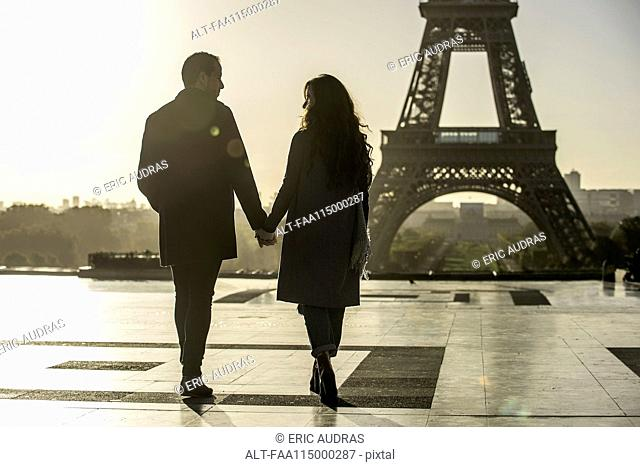Couple walking towards Eiffel Tower