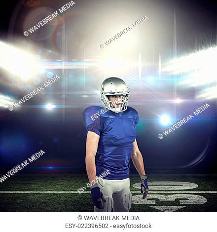 Composite image of confident american football player standing
