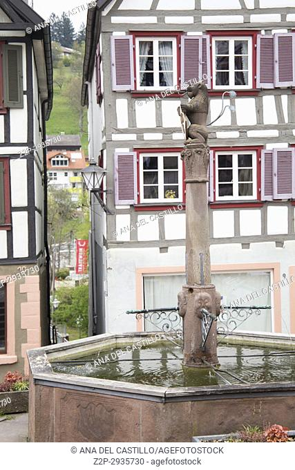 Traditional half-timbered houses located in the historic center of Schiltach, Black Forest, Baden-Wurtemberg, Germany, Europe. Fountain at main square