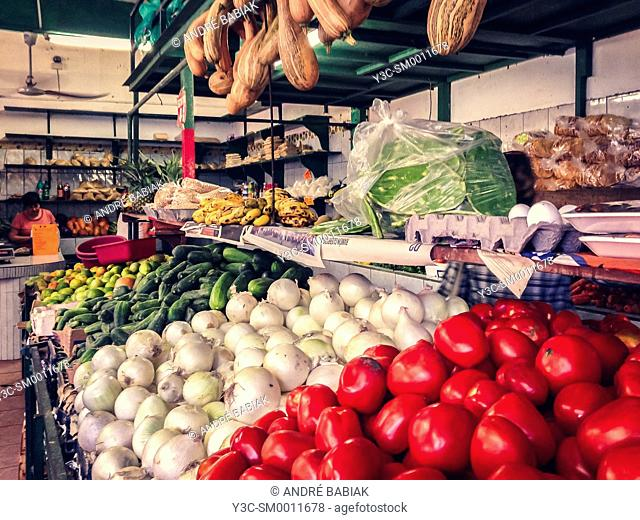 Mexican fruit and vegetable market with tomatoes, onions, cucumbers and more. Puerto Vallarta, Mexico