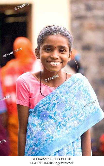Girl in colourful sari ready to play Bhulai on NAG PANCHAMI or cobra festival in Salunkwadi , Ambajogai , Maharashtra , India MR751CB