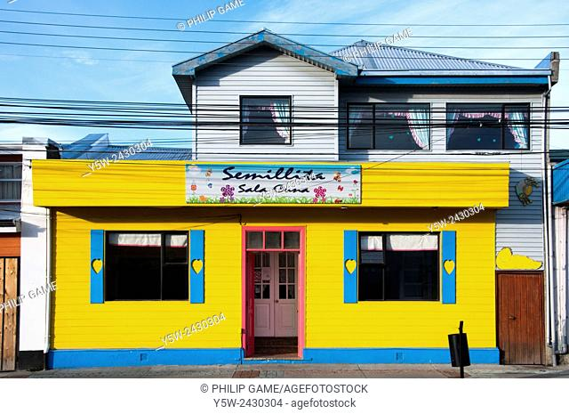 Brightly-painted home and shopfront in Punta Arenas, Patagonia, Chile