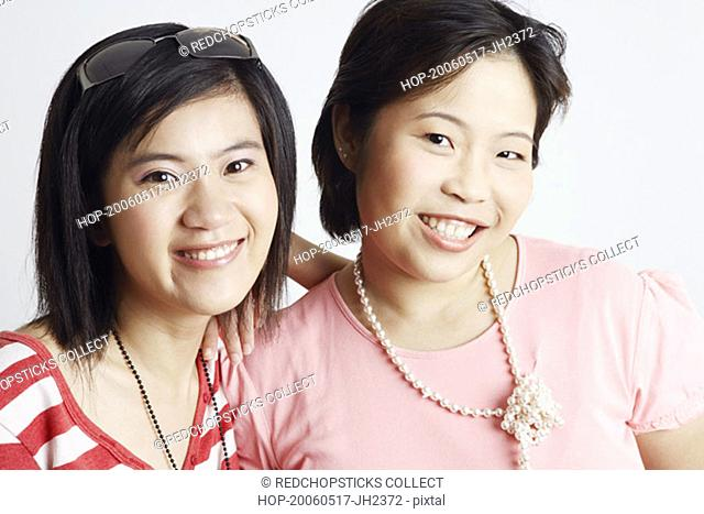 Portrait of two young women smiling
