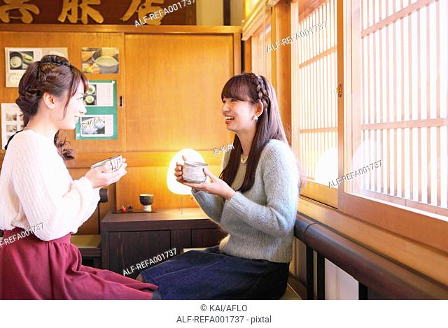 Young Japanese women enjoying Maccha green tea in Kawagoe, Japan