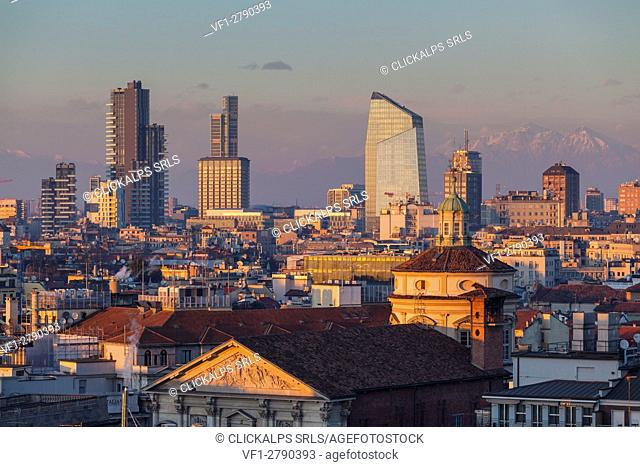 Milan, Lombardy, Italy. The skyscrapers of Milan city at sunset seen from the Cathedral