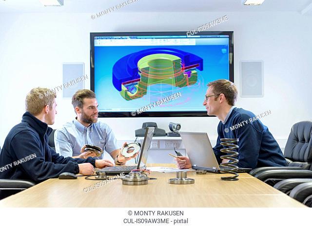 Automotive part designers in design meeting