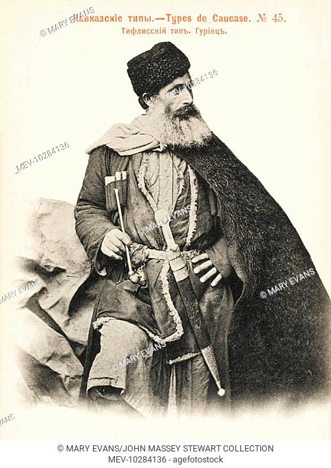 Gurian Man (from Tbilisi, western Georgia), in traditional costume, with a long dagger at his belt and a pipe in his hand