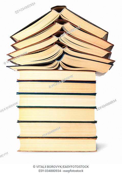 Stack of open and closed old books bottom view isolated on white background