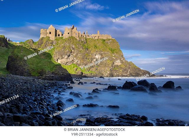Sunrise over Dunluce Castle along northern coast of County Antrim, Northern Ireland, UK