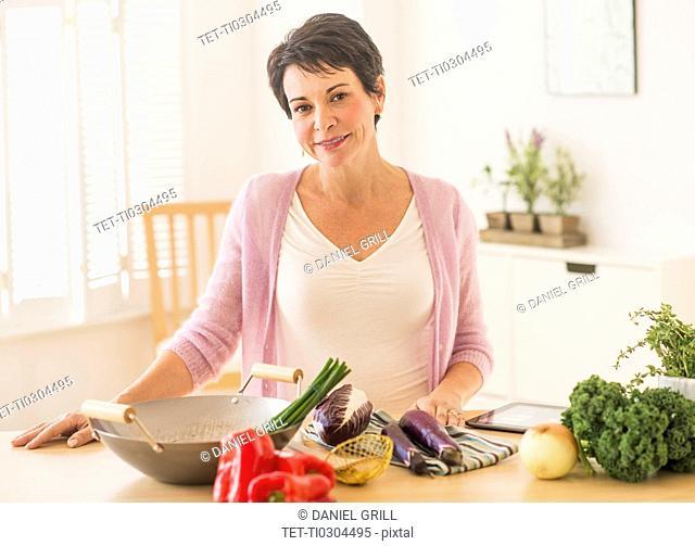 Portrait of mature woman in kitchen