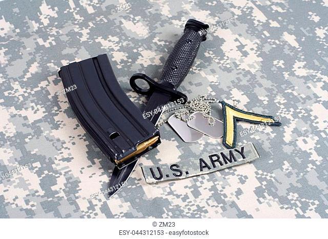 KIEV, UKRAINE - February 6, 2016. M-16 magazine with ammo and bayonet on camouflage US Army uniforms