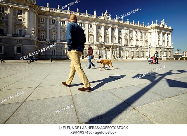 People walking along the Royal Palace. Madrid. Spain