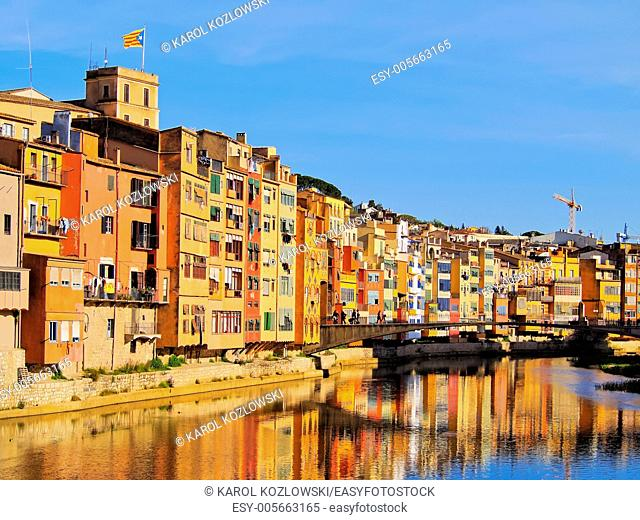 Colorful houses of Girona reflecting in the Onyar River