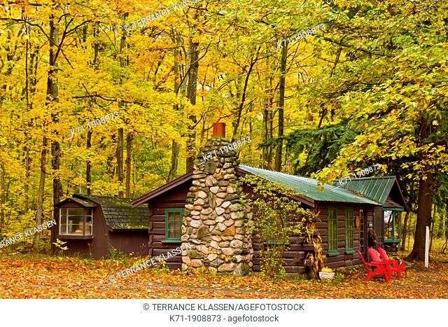 A home in the forest with fall foliage color along Highway 119 in Michigan's Lower Peninsula, USA