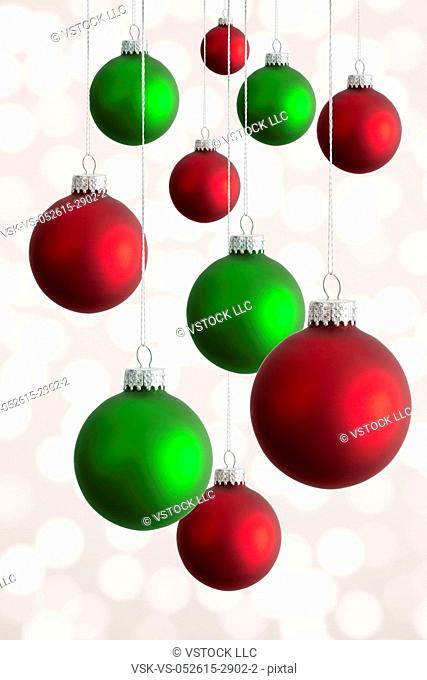 Studio shot of hanging Christmas baubles