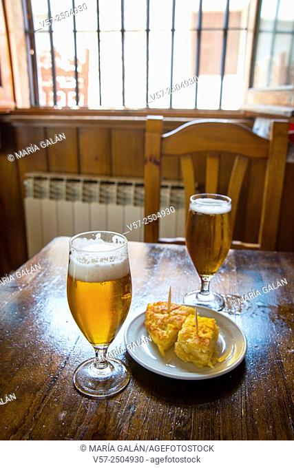 Two glasses of beer and tapa of Spanish omelet