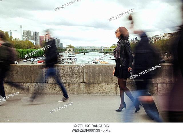 France, Paris, people walking on a bridge