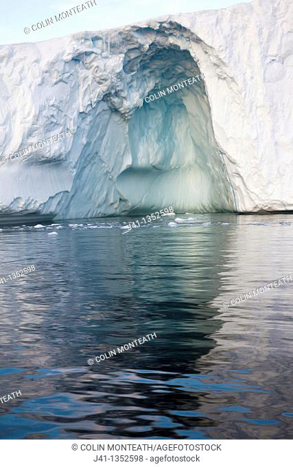 Tunnel and arch forming in iceberg, Cierva Cove, Antarctic Peninsula